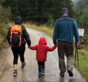 three people walking along a pathway