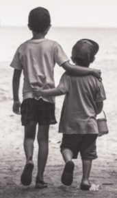 Two boys walking on beach