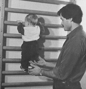 Baby Climbing Up Doorway Gym Bars